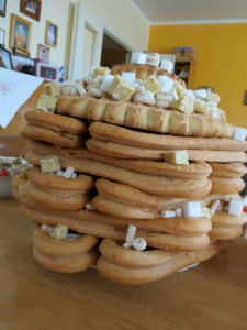 Boov - Every house has one of these towers of biscuit-like cookies with cheese, sugar and candy. Sadly, I don't know the significance, but there's IS a reason!