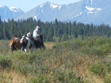 Not everyone had the day off. Clark taking some horses to meet the hunters at the other end of the lake.